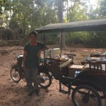 Ta Nei I burst out laughing when I see his fine dishes on the rikschaw in the middle of the jungle. We laugh together and he offers me an apple. Coffee no possible its for customer on bicycle....